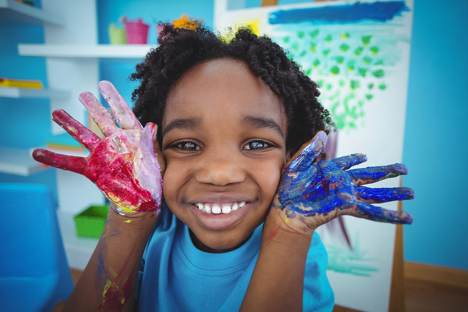 Happy kid enjoying arts and crafts paint