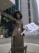 Emmeline - still standing strong in Manchester in 2020 with her GM4women2028 placard