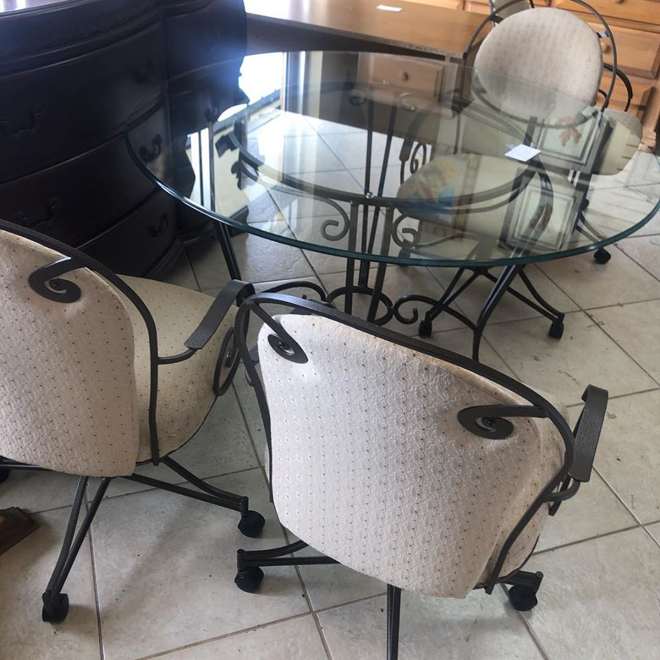 glass dinette with 4 swivel rocker chair