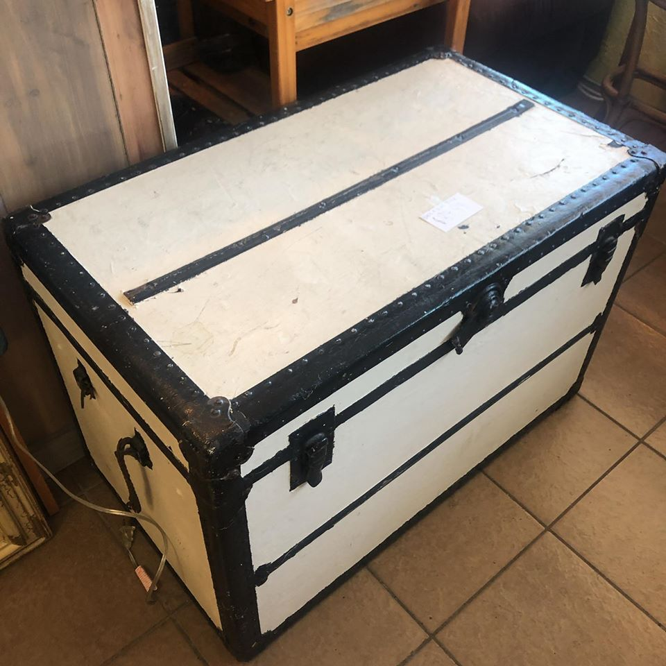 Cream color steamer trunk