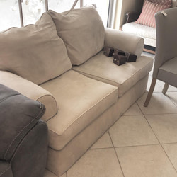 beige upholstered love seat