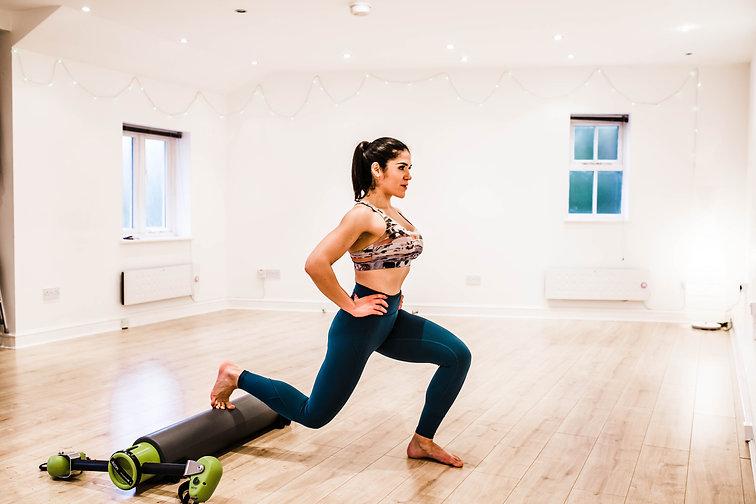 Marta Beacom Personal Trainer lunge in studio