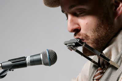 Will West on harmonica Photo by Tim Gunther