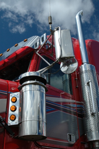 Side view of a red semi-truck