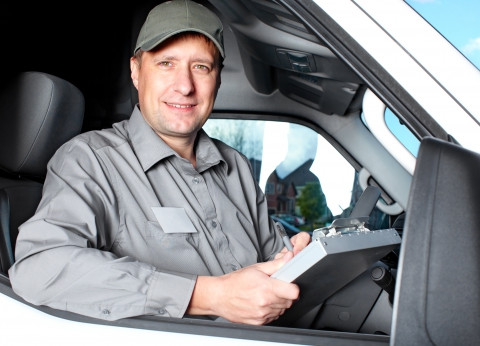 male driver staring out truck window