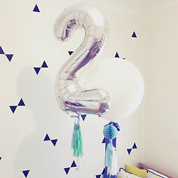 Balloons with tassels. Giant foil balloon number. Bespoke balloons.