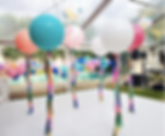 Giant balloon with tassels for weddings or parties. Jumbo balloons adelaide. Bespoke balloons Adelaide. Balloon Garland. Balloon Installation Adelaide.