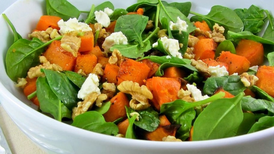 Roast sweet potato salad with baby spinach and walnuts