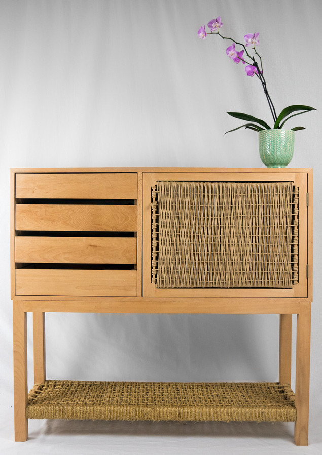 Front view. The drawers on the left have hidden grooves as handles while the cabinet door as a woven pull.
