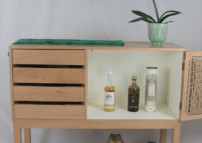 The large cabinet can be paritioned wit a shelf for more versatile storage. Or left tall for bottles