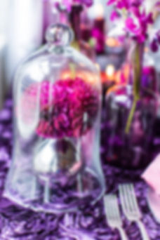 Black Satin Dahlia under a glass dome in a silver vase on a Purple Rosette Linen Photo Credit: Sharon Nicole Photography #EventDesign #PoshAndPrivate