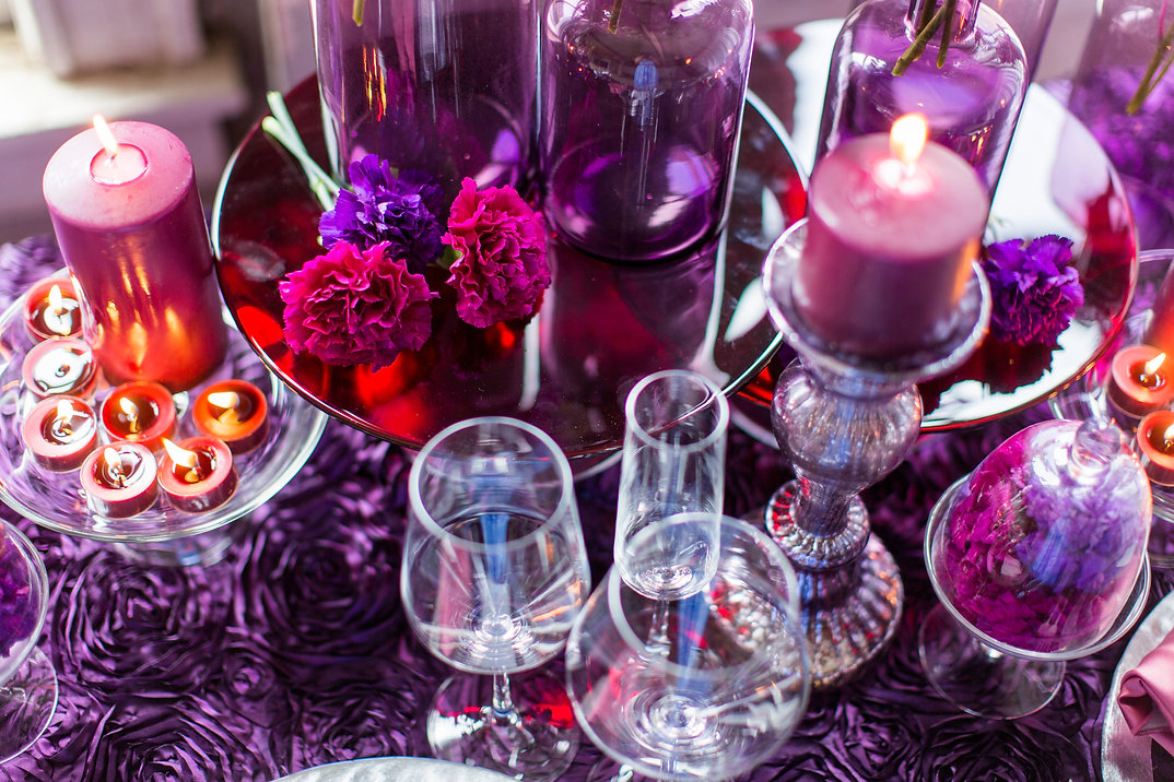 Purple and Fuschia Moon Series Carnations with Purple Votives on Purple Rosette Linen Photo Credit: Sharon Nicole Photography #EventDesign #PoshAndPrivate