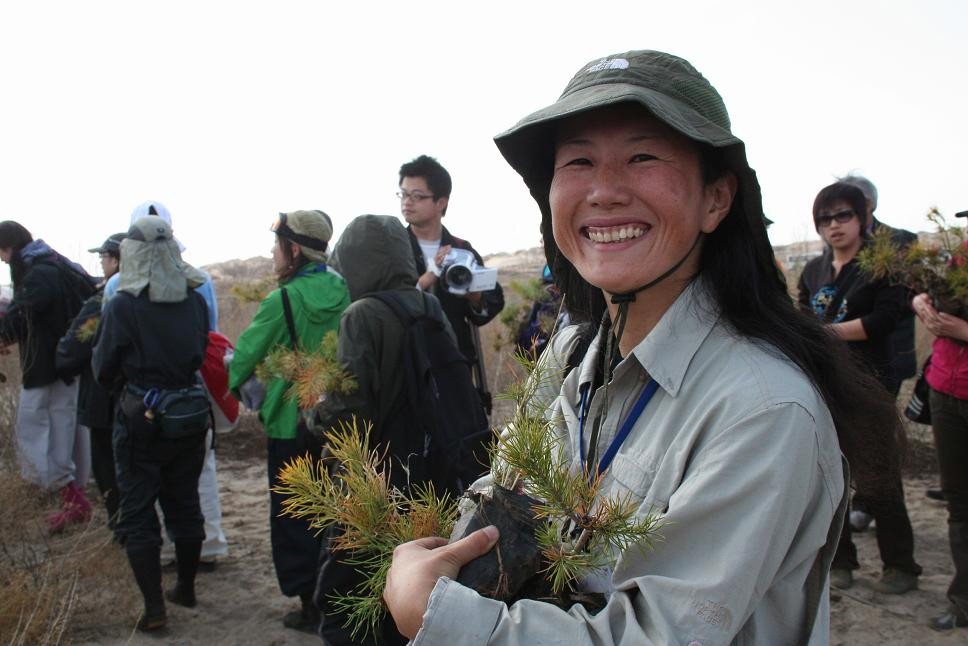 A very happy Konomi Kikuchi with an armful of trees