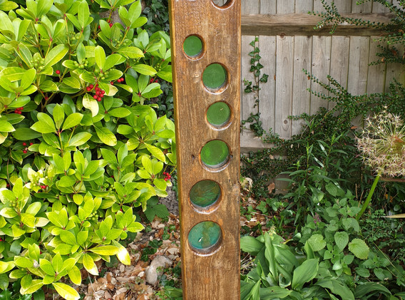 Green glass and wood garden ornament