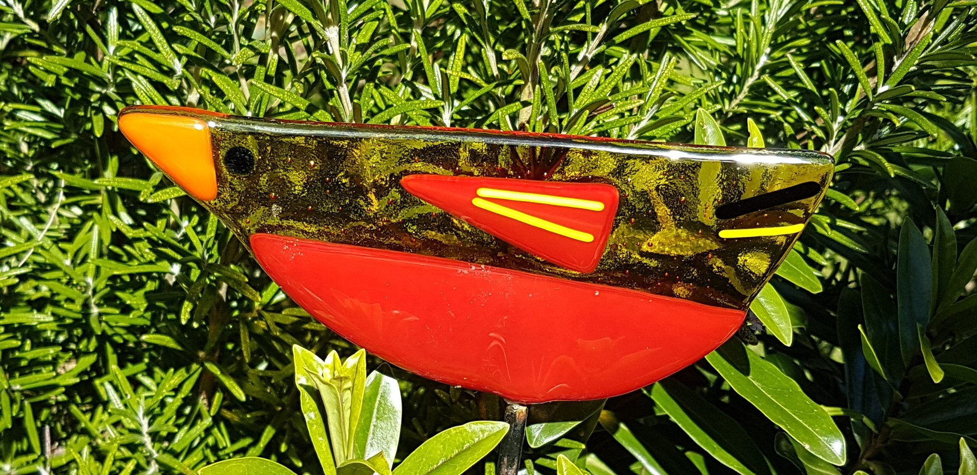 Glass bird on a stake for the garden