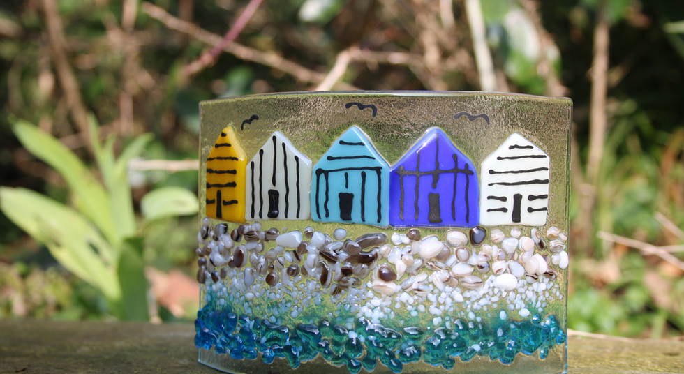 Glass beach huts