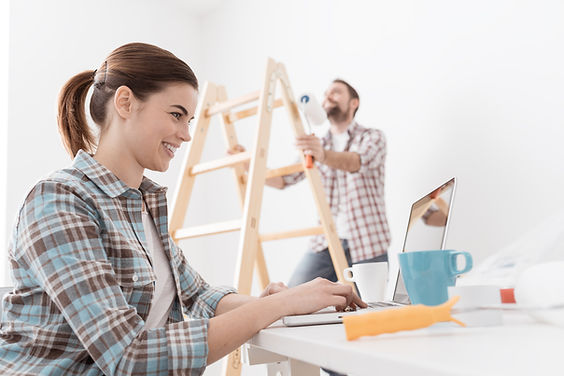 Young smiling couple renovating and remo