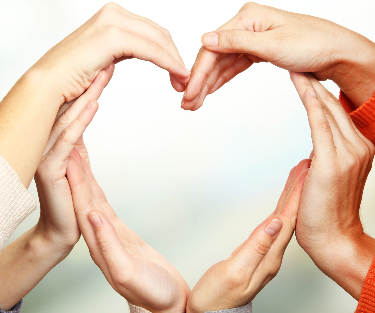 Human hands in heart shape on bright background_edited.jpg