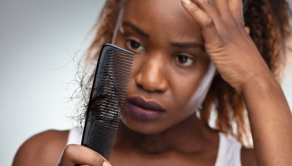 Close-up Of African Shocked Woman Suffer