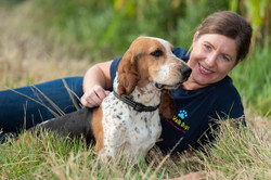 Professional Dog Walker laying with a Basset Hound at Netherclay in Taunton