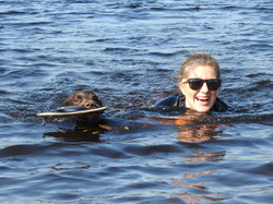 Dog walker from Taunton swimming with her dog