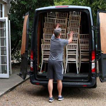 Small Business Owner Unloading a Van