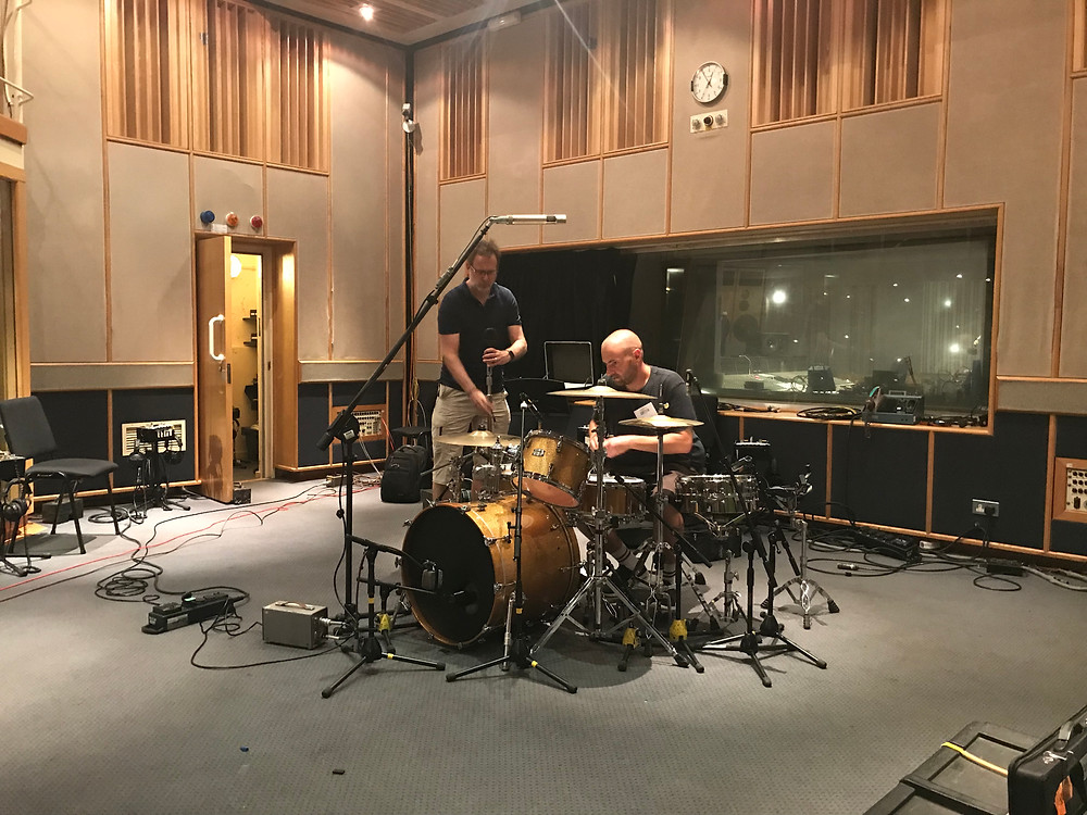 Engineer Guy and The Skints tech Tom setting drums up in BBC Maida Vale Studios
