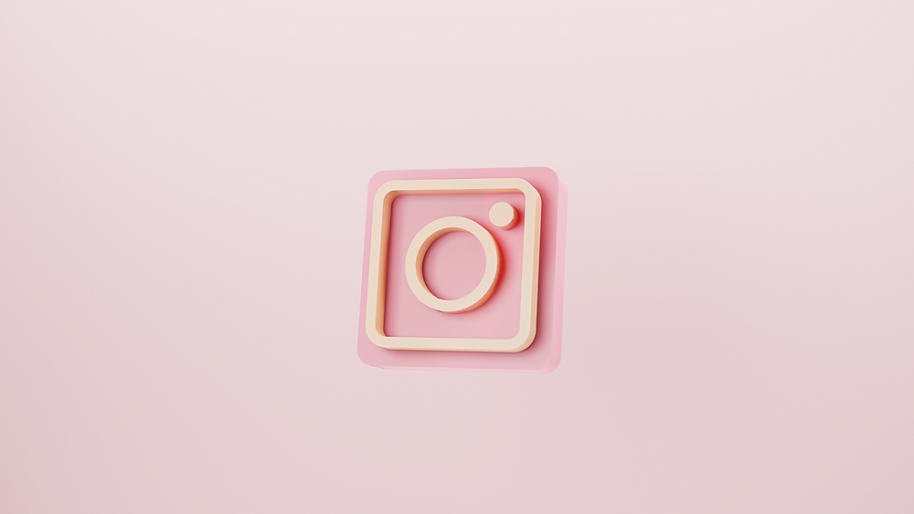 Instagram logo on a pink background