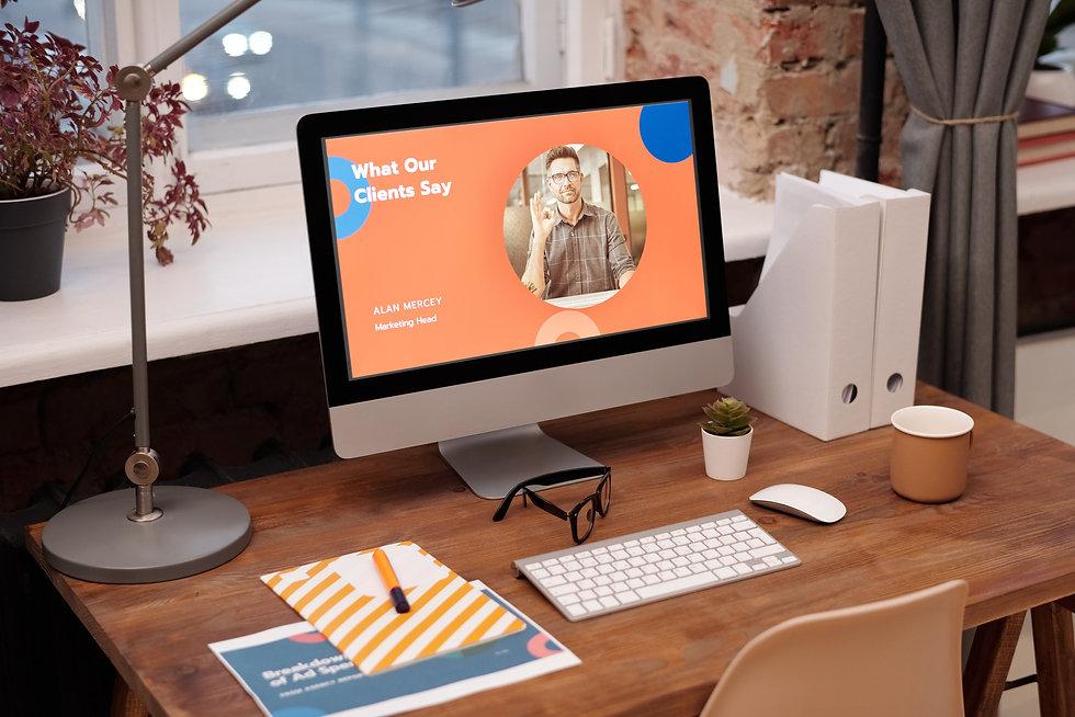 Imac on desk wit orange screen