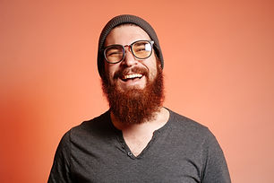 Close up portrait of happy smiling beard
