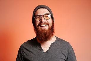 Close up portrait of happy smiling beard