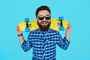 Young hipster bearded man with a yellow