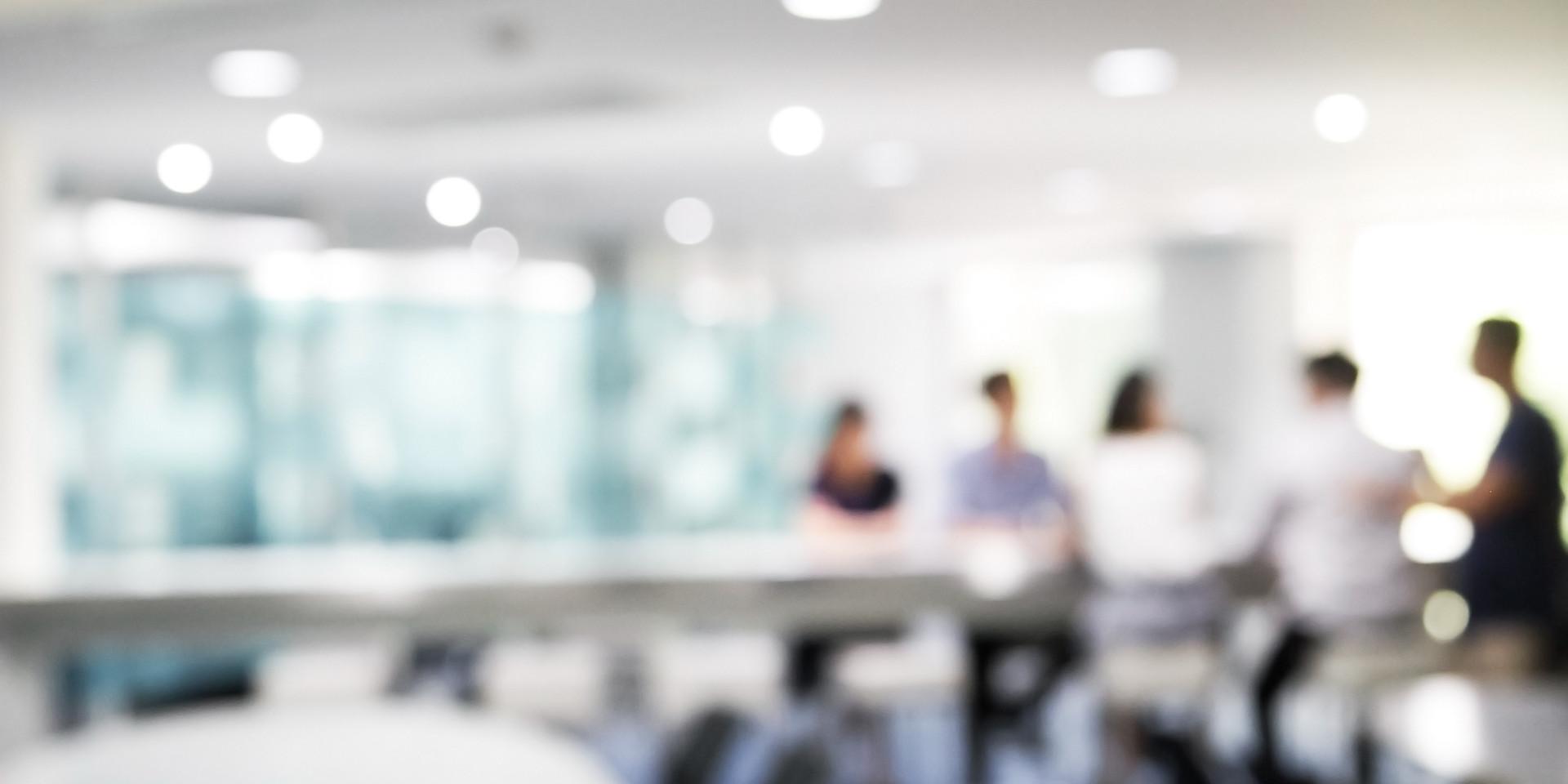 Blurred image of people meeting.