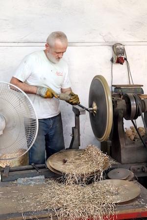 Lathing a cymbal.