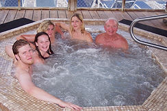 People in smaller hot tub