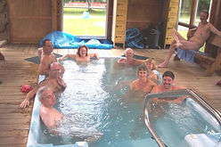Group of people in large conversation hot tub