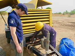 Ben helping with generator in SSudan May