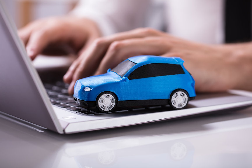 Close-up Of A Small Blue Car On Laptop K