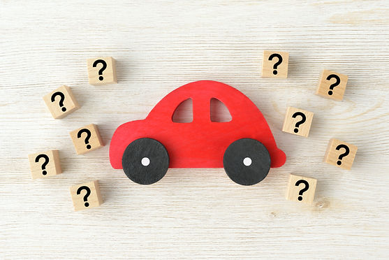 Red car toy and wooden blocks with quest