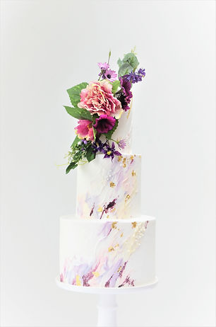 Modern paint effect wedding cake