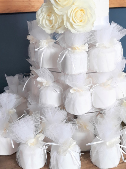 mini wrapped wedding cakes.jpg