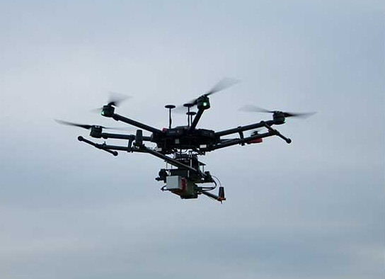 DJI Matrice Drone in flight with LiDAR payload