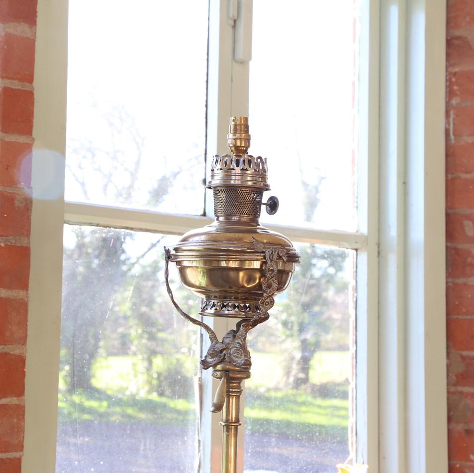 Tall brass lamp standard