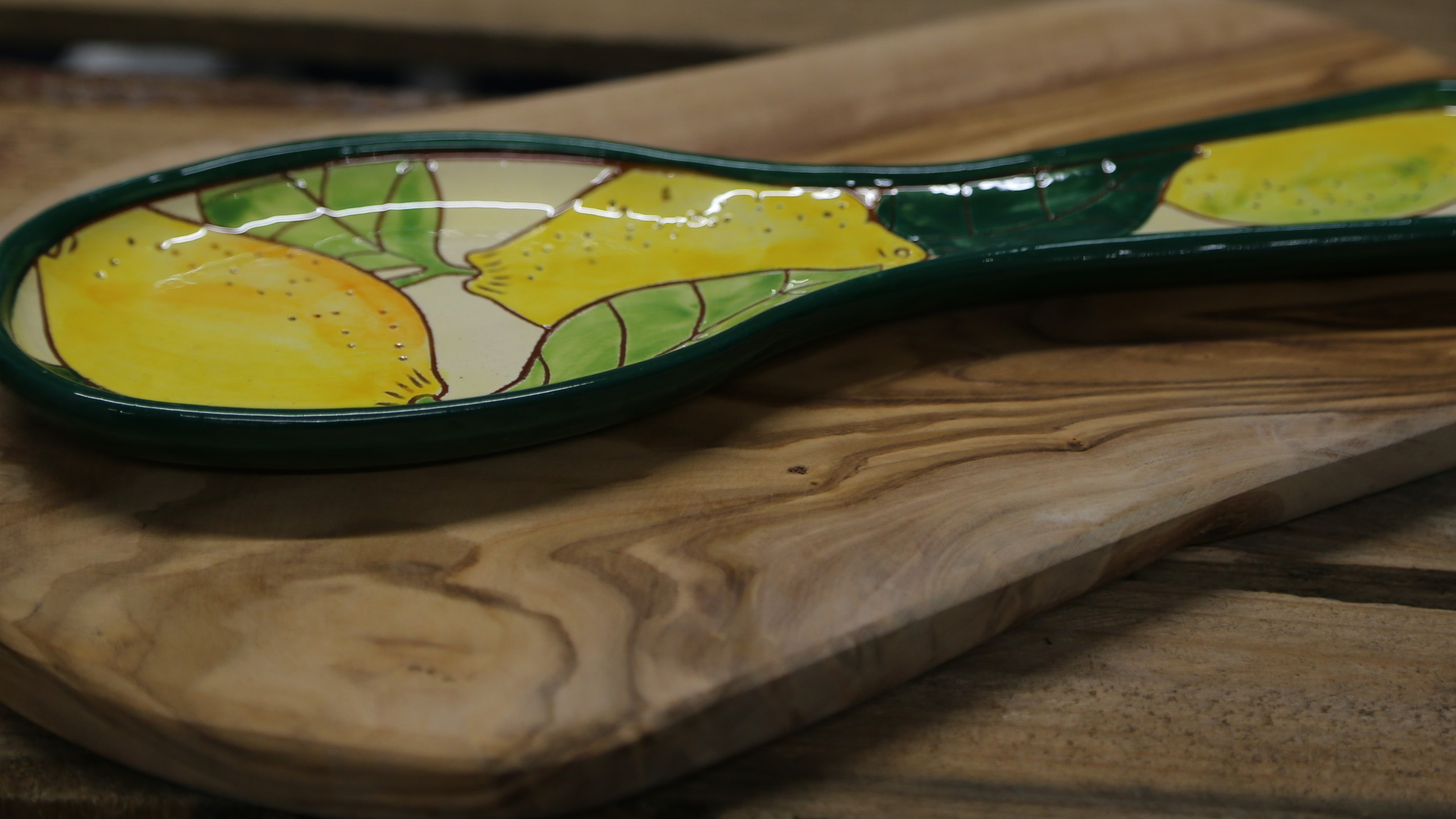 Citrus board and spoon holder