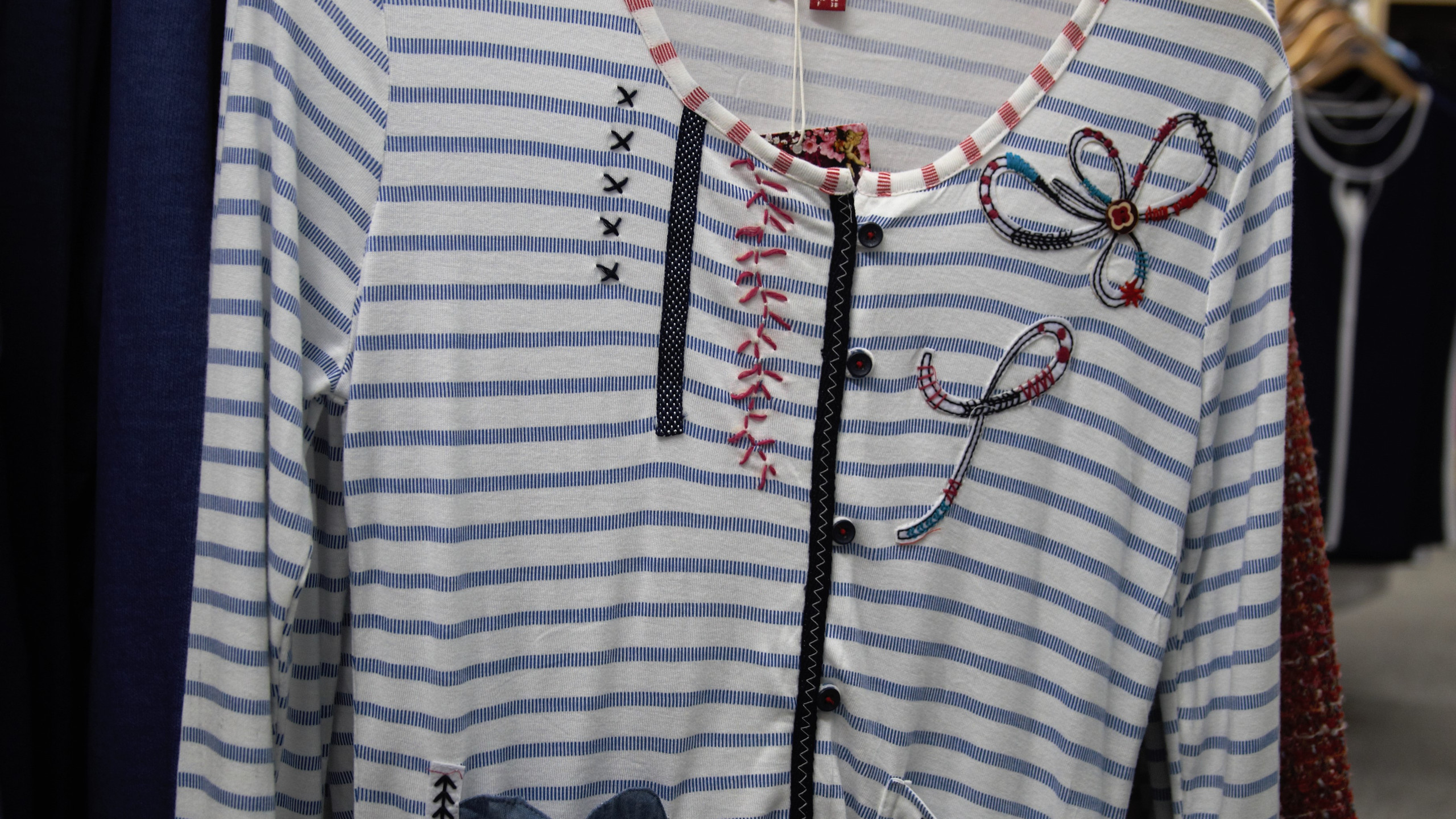 Striped top with detailing