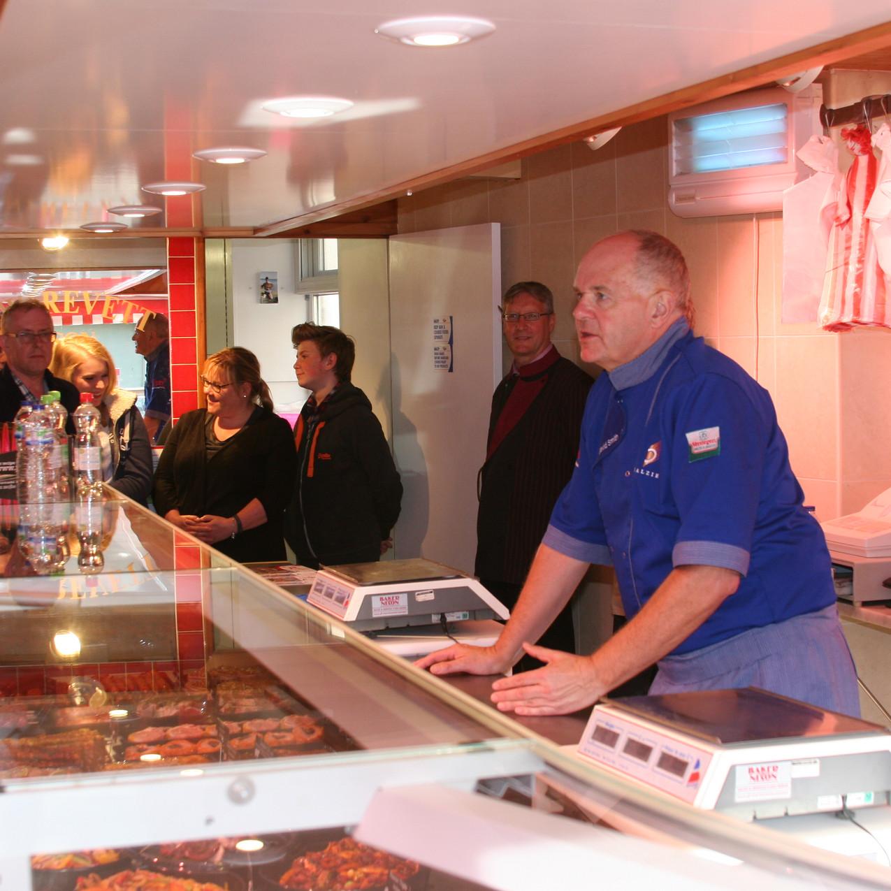 An expert teaches the local butchers