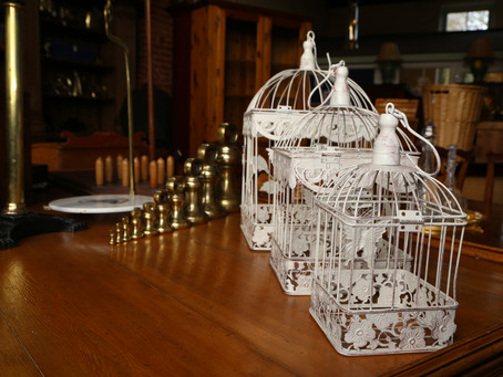 A set of three metal bird cages - SOLD