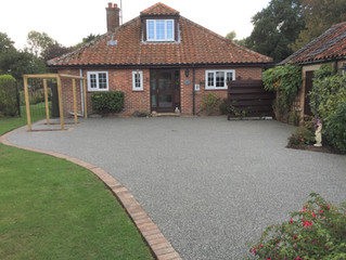 A fantastic resin driveway to enhance the house
