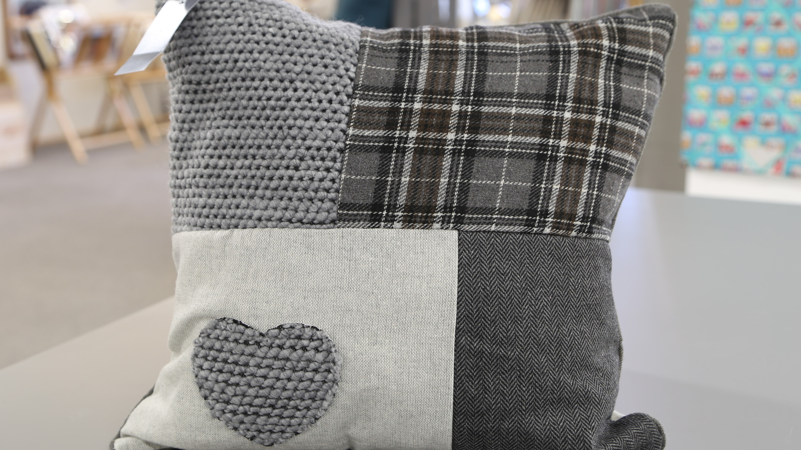 Grey patchwork cushion with heart