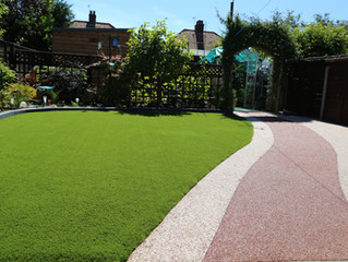 A mix of artificial grass and resin pathway